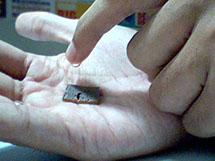 image showing someone using black stone