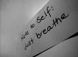 """hand written note saying """"just breathe"""""""
