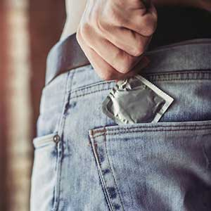 man getting a condom out of his pocket