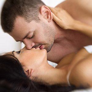 man and woman kissing in foreplay