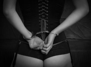 image of a woman with bdsm gear on