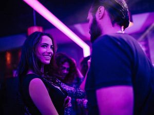 image of a woman and an unknown man in a bar flirting