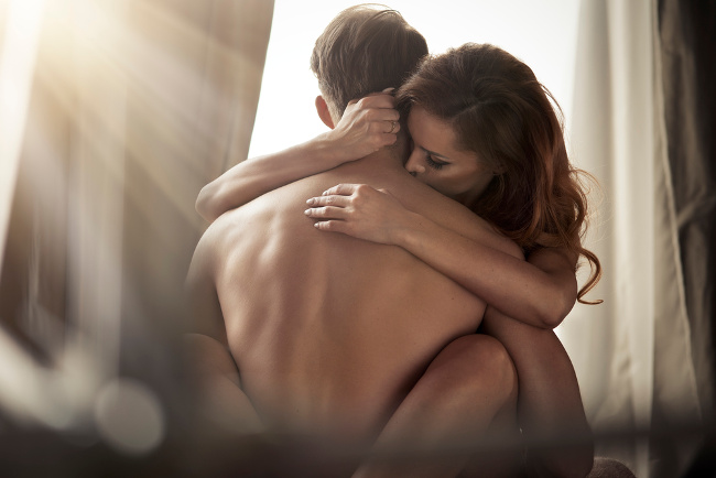 couple hugging intimately in the classic tantric sex position