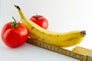 image of a banana next to a ruler to suggest measuring penis size