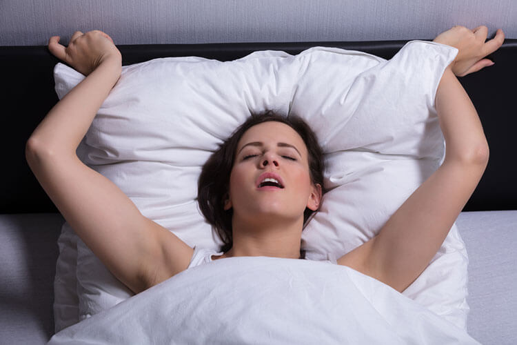 photo of a woman's facial expression during orgasm
