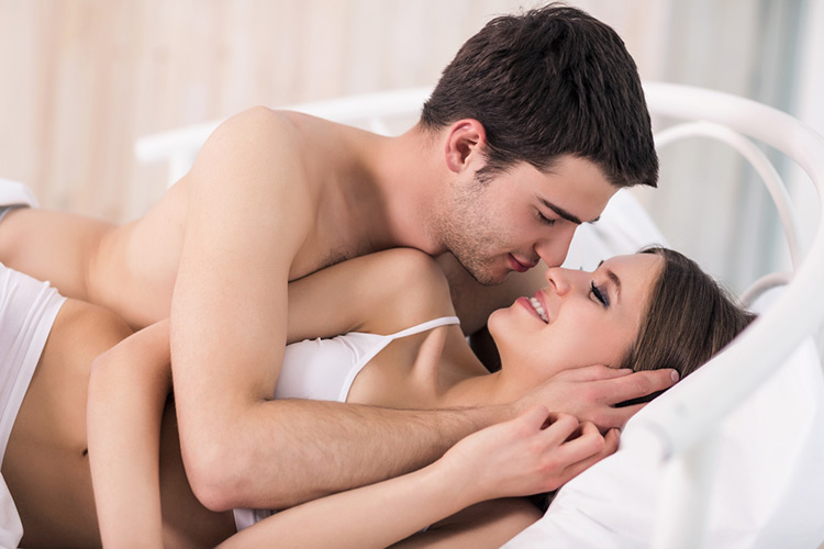 image of a happy man and woman in bed together