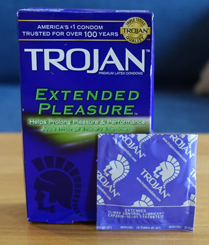 photo of one trojan extended pleasure delay condom and a standard box